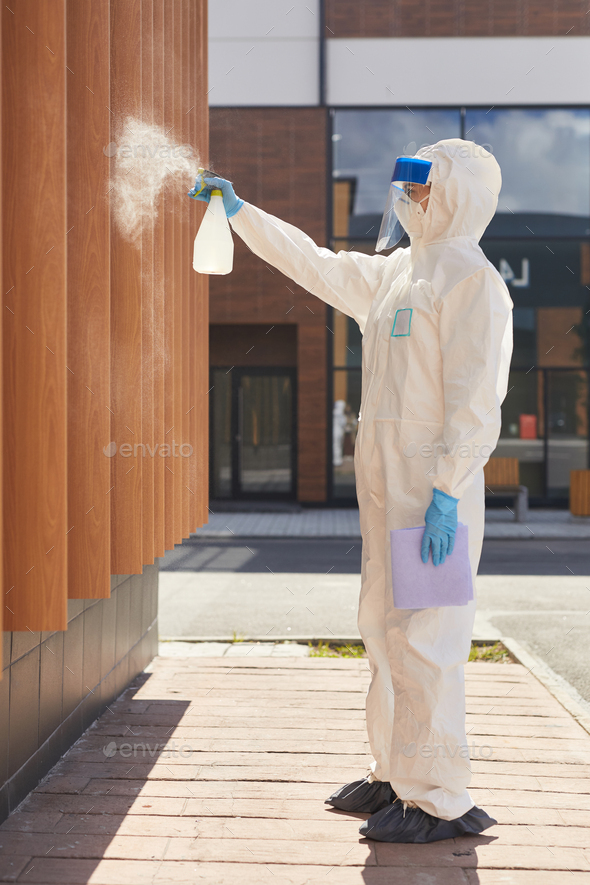 Worker Disinfecting Building Side View - Stock Photo - Images