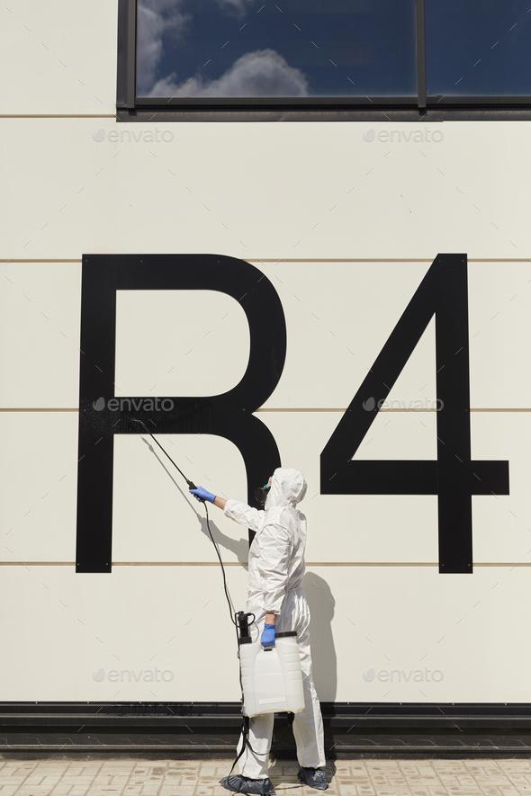 Worker Disinfecting Hangar - Stock Photo - Images