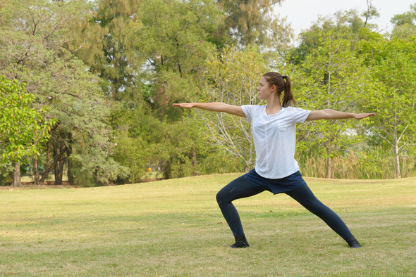 Young beautiful woman exercising at the park outdoors - Stock Photo - Images
