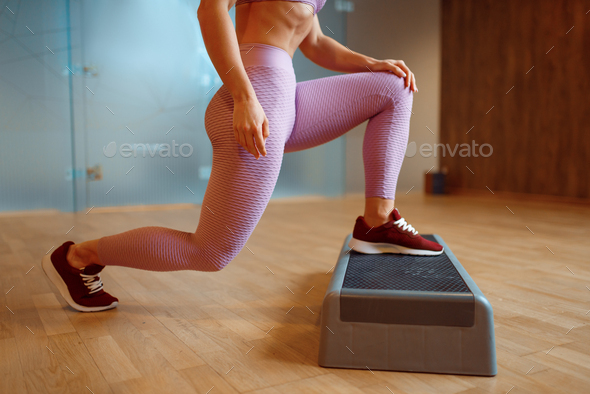 Female person doing exercise with stand in gym - Stock Photo - Images