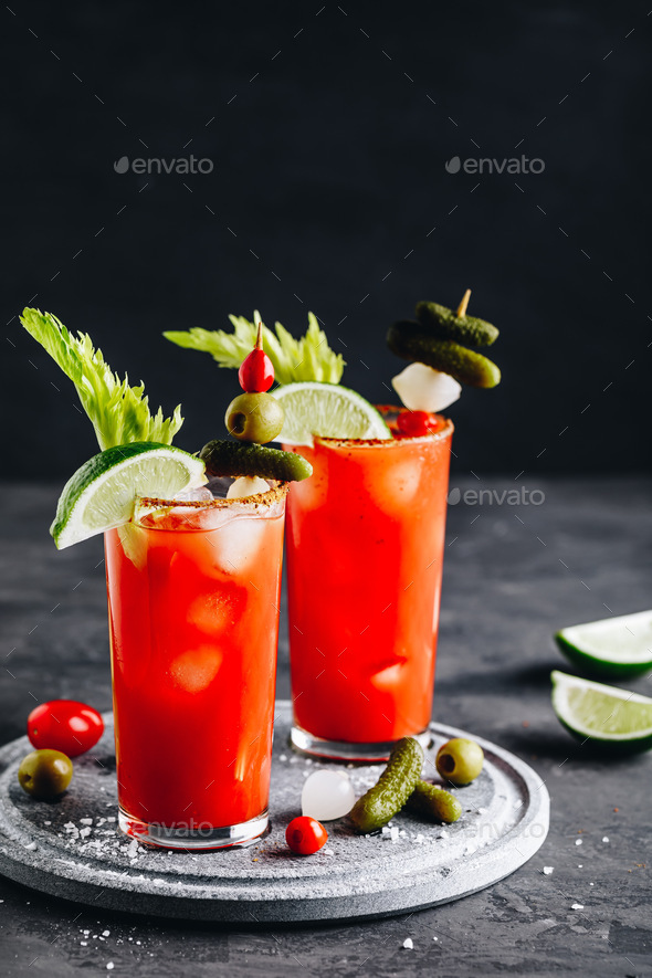 Bloody Mary Cocktail in glasses with garnishes. - Stock Photo - Images