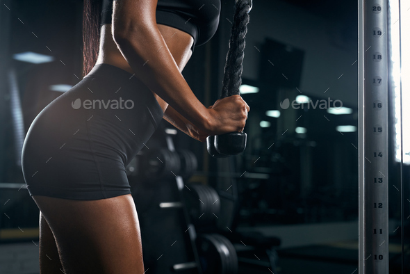 Female bodybuilder training triceps in gym - Stock Photo - Images