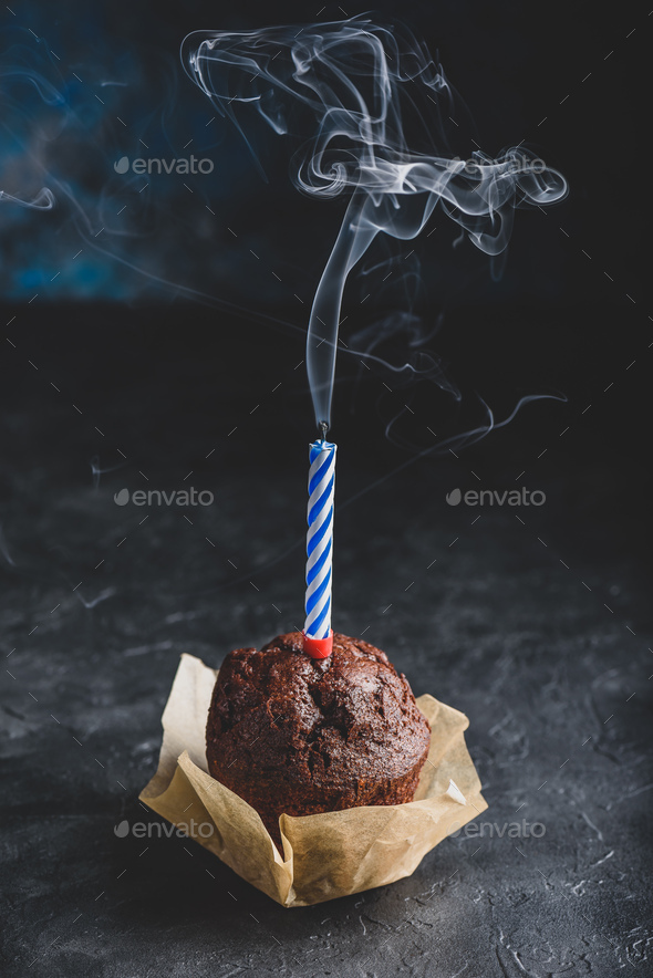 Birthday chocolate muffin with blew out candle - Stock Photo - Images