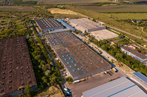 Top view industrial area warehouses in a green region - Stock Photo - Images