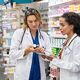 Two pharmacists working together at pharmacy - PhotoDune Item for Sale