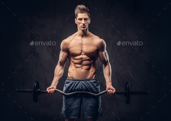 Shirtless man with stylish hair and muscular ectomorph doing the exercises with the barbell - Stock Photo - Images