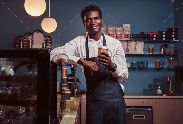Handsome African barista at coffee shop. - Stock Photo - Images