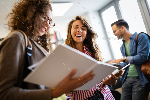 Young university students studying together. Group of multiracial friends in college - Stock Photo - Images
