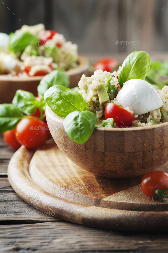 Vegetarian salad with quinoa, tomato and avocado - Stock Photo - Images