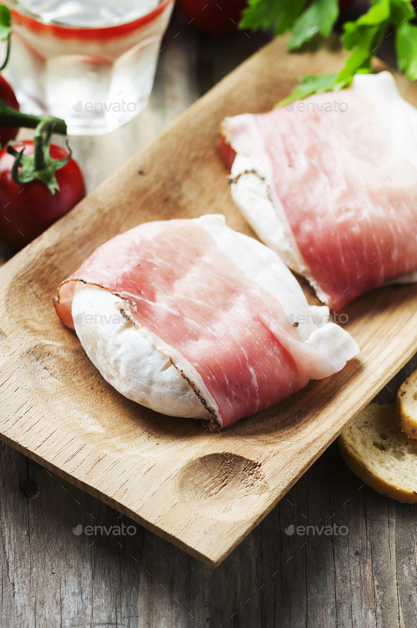 Traditional italian cheese tomino with bacon - Stock Photo - Images