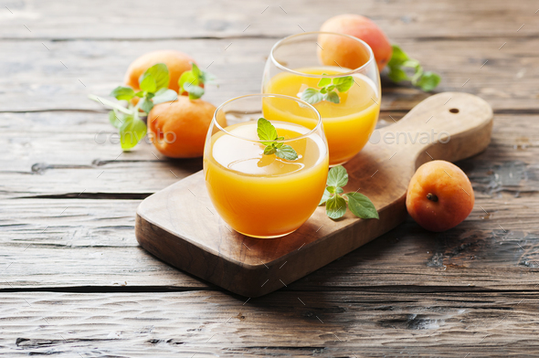 Healthy apricot juice with mint on the wooden table - Stock Photo - Images