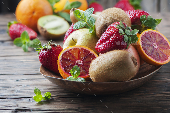 Concept of vegan eating with fresh fruits - Stock Photo - Images
