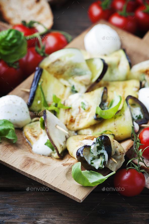 Eggplant rolls with mozzarella cheese - Stock Photo - Images