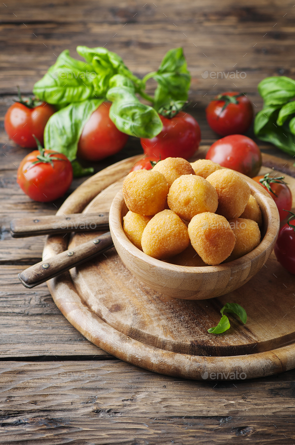Traditional italian fried balls of mozzarella - Stock Photo - Images