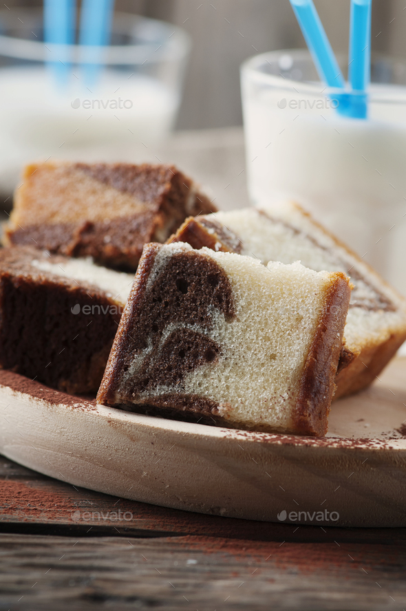 Sweet homemade marble cake with milk - Stock Photo - Images