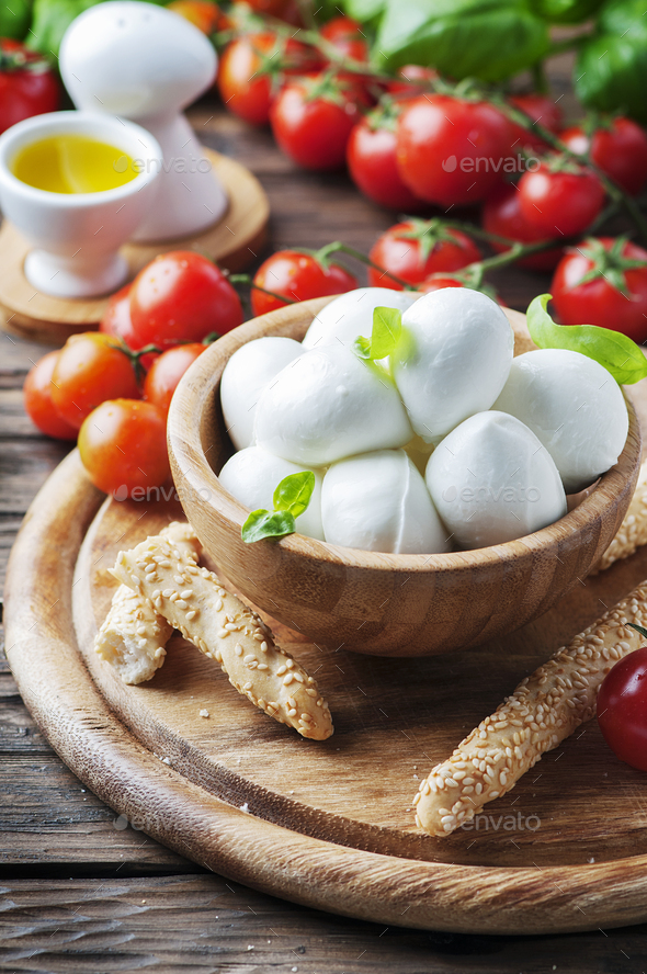 Italian mozzarella with tomato and basil - Stock Photo - Images