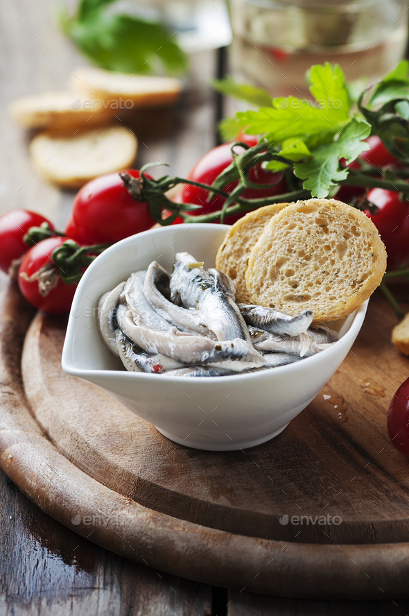 Italian traditional anchovy with bread and tomato - Stock Photo - Images