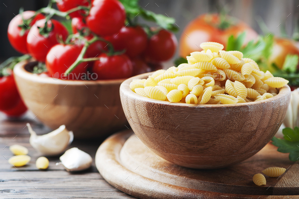 Sardinian uncooked pasta malloreddus on the wooden table - Stock Photo - Images