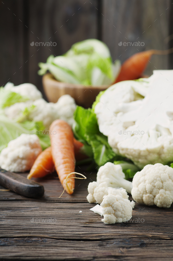 Fresh raw cauliflower and carrot on the wooden table - Stock Photo - Images