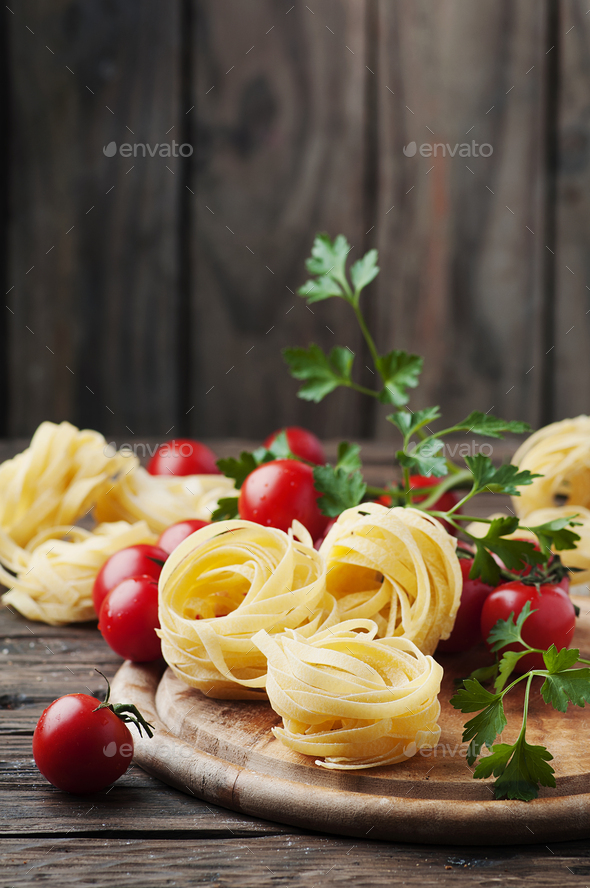 Ingredients for cooking pasta and tomato on the table - Stock Photo - Images