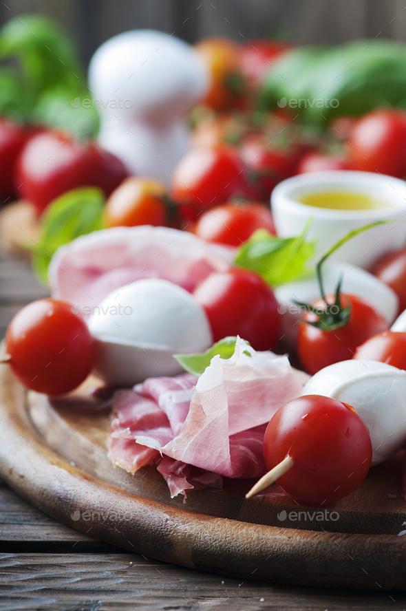 Fresh prosciutto with basil and mozzarella - Stock Photo - Images