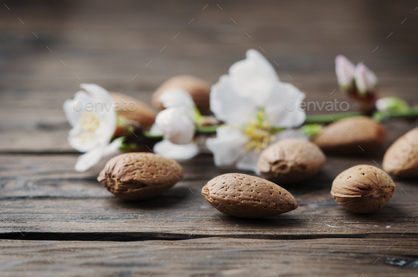 Fresh almond and flowers on the wooden table - Stock Photo - Images