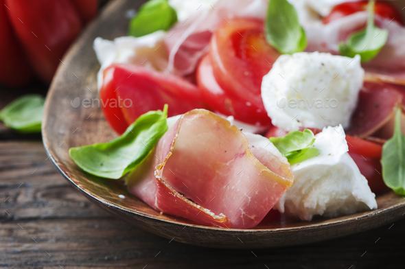 Italian salad caprese with ham and mozzarella - Stock Photo - Images