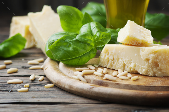 Basil, cheese, pine and olive oil on the wooden table - Stock Photo - Images