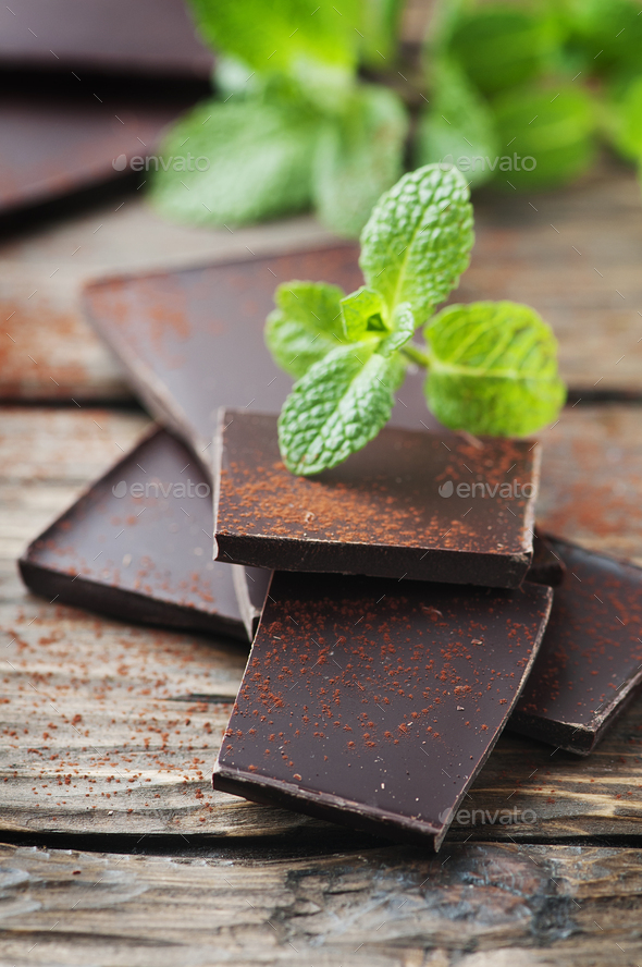 Dark healthy chocolate with green mint - Stock Photo - Images