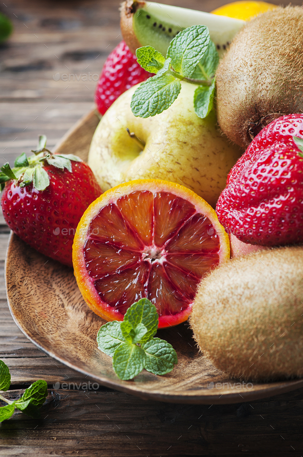 Mix of fresh fruits on the wooden table - Stock Photo - Images