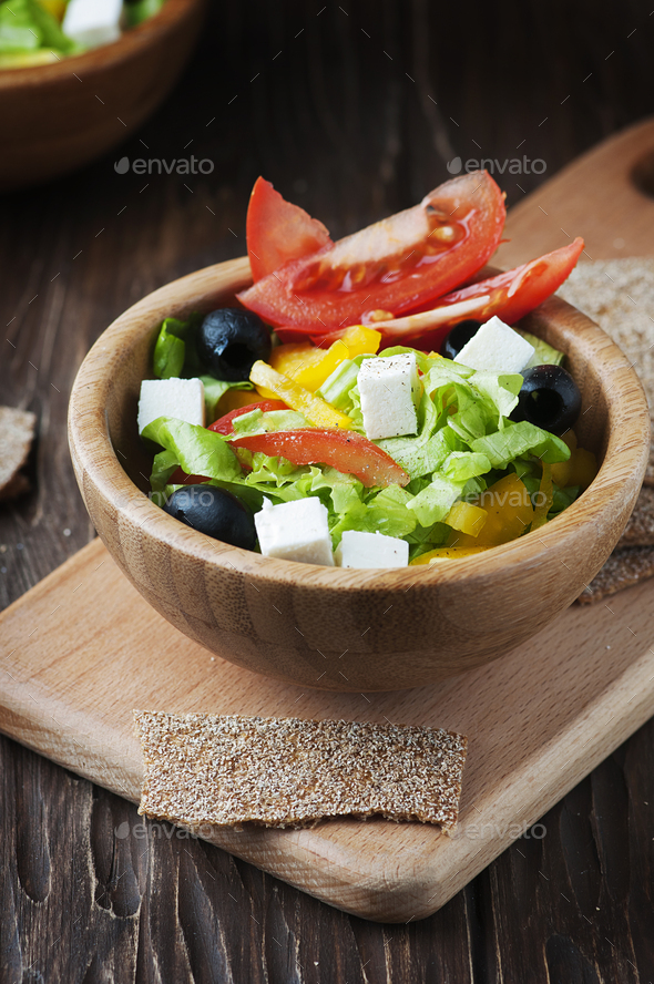 Fresh Greek salad with olive oil - Stock Photo - Images