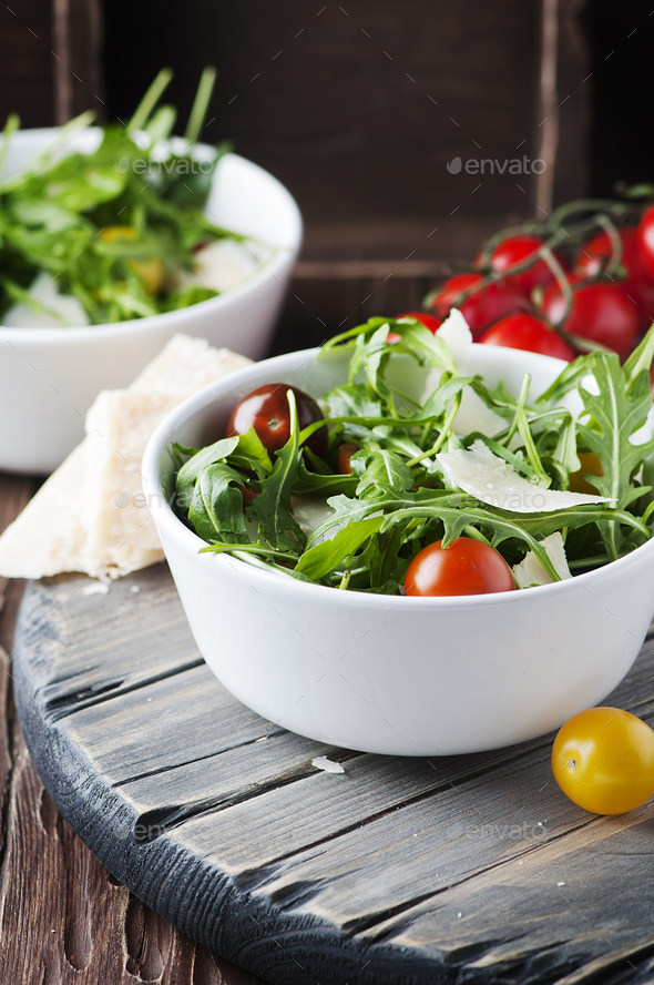 Healthy salad with rocket, tomato and parmesan cheese - Stock Photo - Images