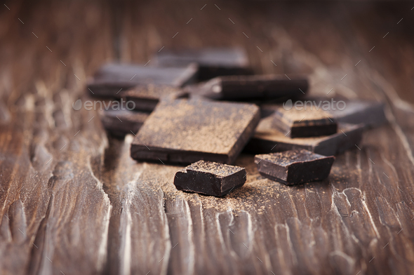 Dark chocolate on the wooden table - Stock Photo - Images