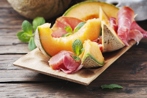 Italian prosciutto with sweet fresh melon - Stock Photo - Images