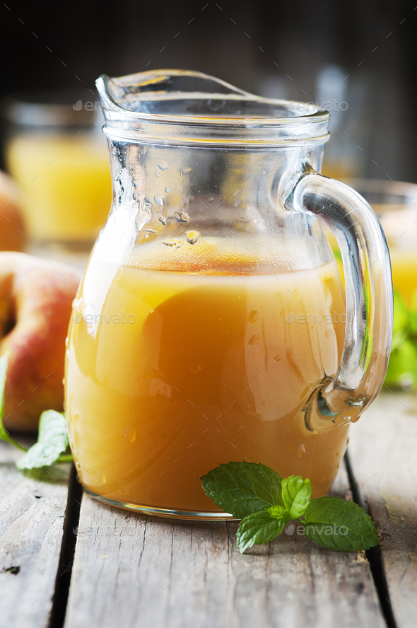 Fresh peach juice with mint on the wooden table - Stock Photo - Images