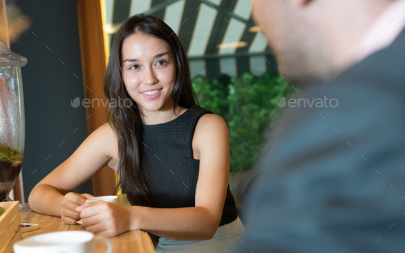 Woman and man together at the coffee shop - Stock Photo - Images
