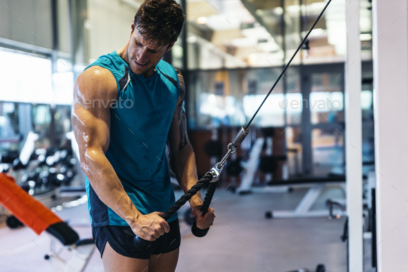 Man training in club gym. - Stock Photo - Images