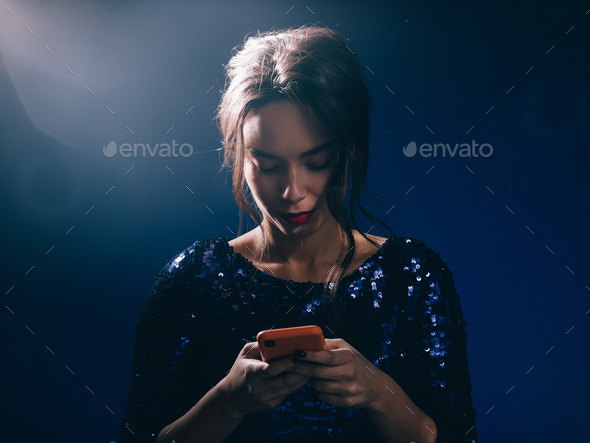 Woman in sequin dress night club concept red lips asian beauty - Stock Photo - Images