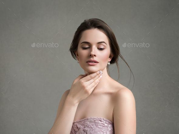 Beautiful woman art portrait studio over gray background - Stock Photo - Images