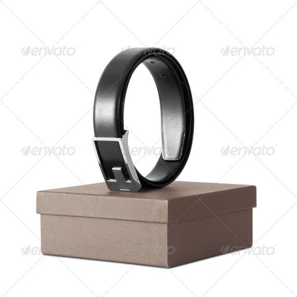 Man's black belt on box isolated on white - Stock Photo - Images