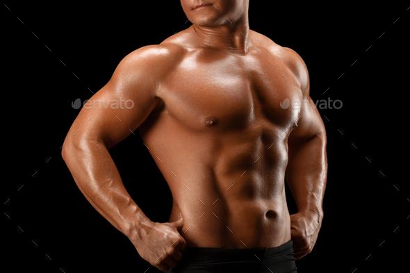 Sport man body studio on black background - Stock Photo - Images