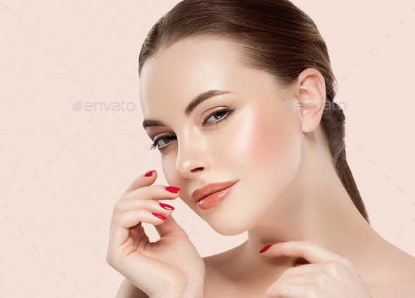 Beauty woman healthy skin concept natural makeup beautiful model girl face hands touching - Stock Photo - Images