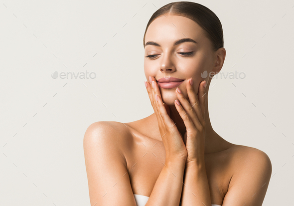 Beautiful young model cosmetic concept portrait tanned skin - Stock Photo - Images