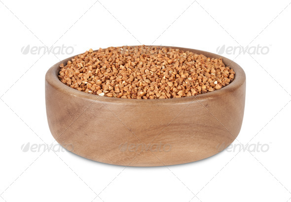 Buckwheat in  wooden bowl - Stock Photo - Images