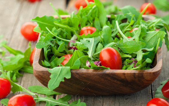 mixed salad in wood with cherry tomatoes - Stock Photo - Images