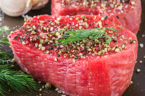 Raw Beef Steak with Fresh Spices - Stock Photo - Images
