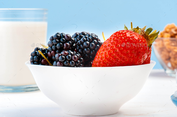 Fresh berries in glass pot. - Stock Photo - Images