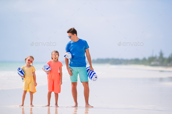 Father and little kids on the beach - Stock Photo - Images