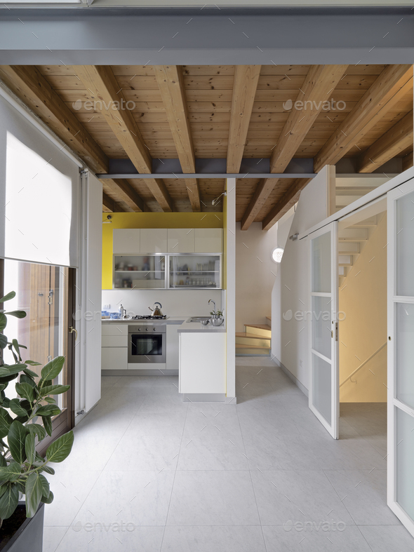 Interiors of a Modern Kitchen in the Attic Room - Stock Photo - Images