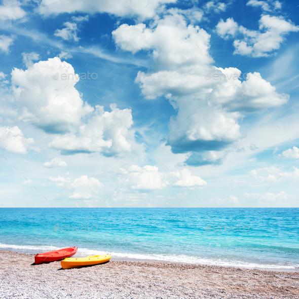 Two kayaks on sea edge - Stock Photo - Images